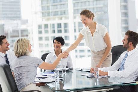 Executives shaking hands during a business meetingの素材 [FYI00000074]