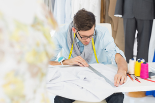 Male fashion designer working on his designsの素材 [FYI00000096]