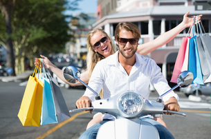 Attractive couple riding a scooterの素材 [FYI00003391]