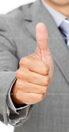 Close up of a businessman with thumb upの素材 [FYI00482205]