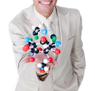 Smiling businessman talking about biologyの素材 [FYI00482217]