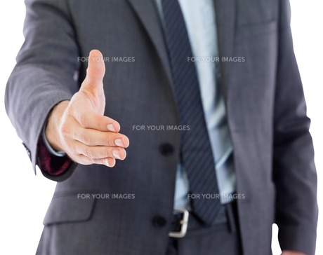 Businessman reaching hand outの素材 [FYI00485916]