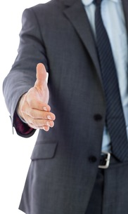 Businessman reaching hand outの素材 [FYI00485917]