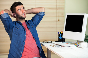 Handsome hipster working at deskの素材 [FYI00486416]