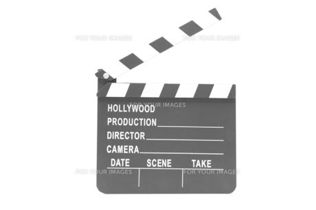 Film slate standing against white backgroundの素材 [FYI00486605]