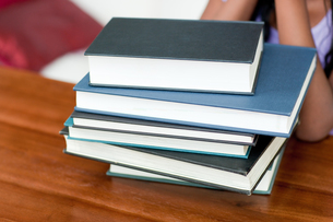 Stack of books on a tableの素材 [FYI00488947]